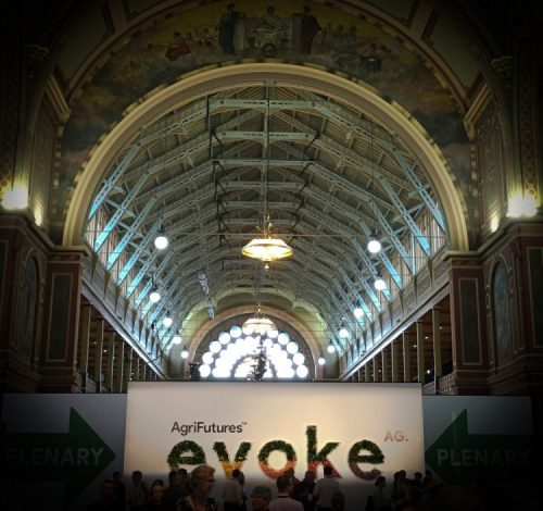AgriFutures evokeAG sign in the entrance hall of the heritage-listed Royal Exhibition Building in Melbourne, looking up at the vaulted ceiling.